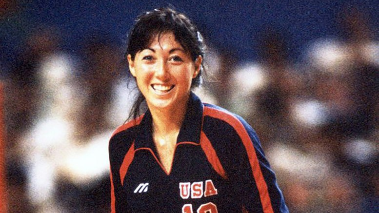 Color photo of Debbie Green-Vargas in her Team USA #10 warm-up jacket