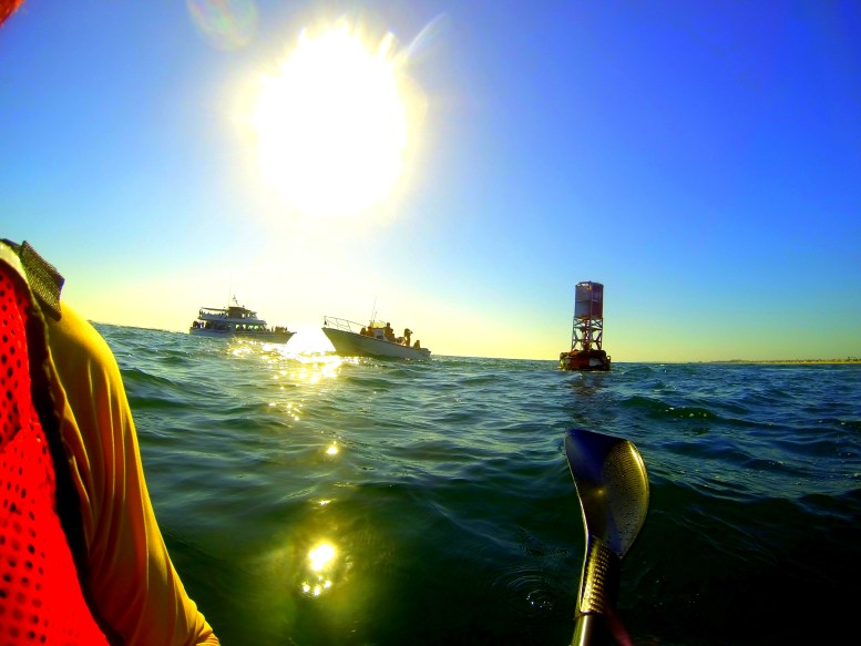 sitting in my Fenn surf ski out at the buoy at the entrance to Newport Harbor on a Saturday in October with a couple of boats circling around the buoy