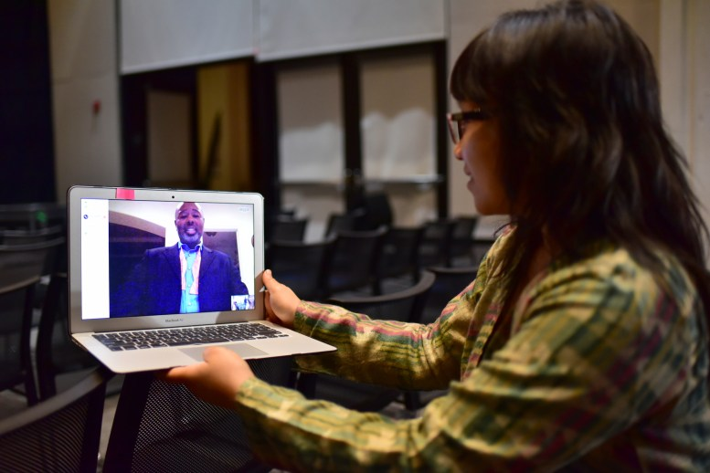 TEDxCSULB '17 curator Camille Raquel on Skype with speaker Brandon Gamble