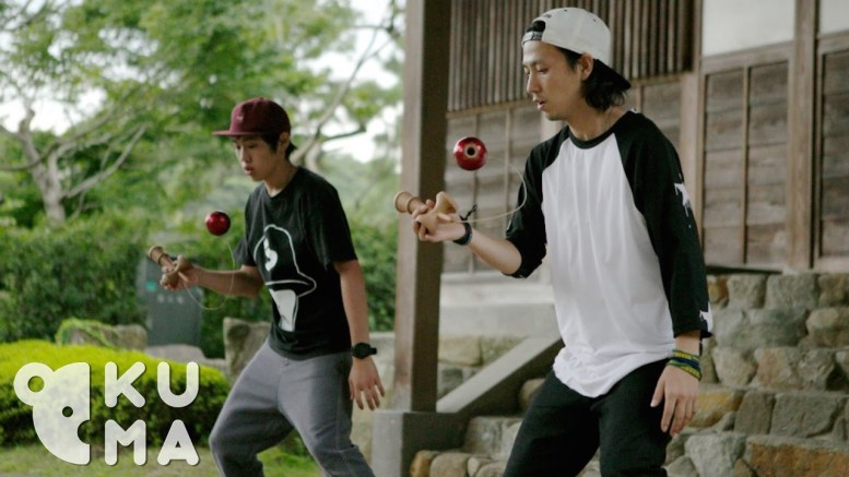 2 guys doing synchronized kendama