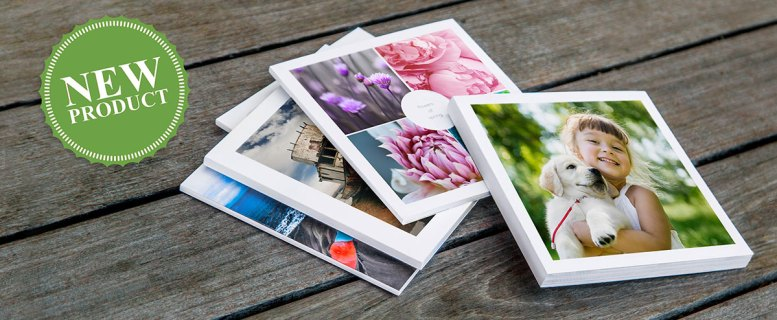 photo of several photo books on a table