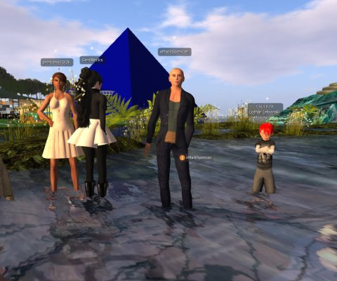 avatars standing in shallow water in front of a large Blue Pyramid, the unofficial architectural logo of CSULB