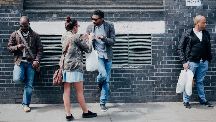 group of people chatting on a London street in 2013