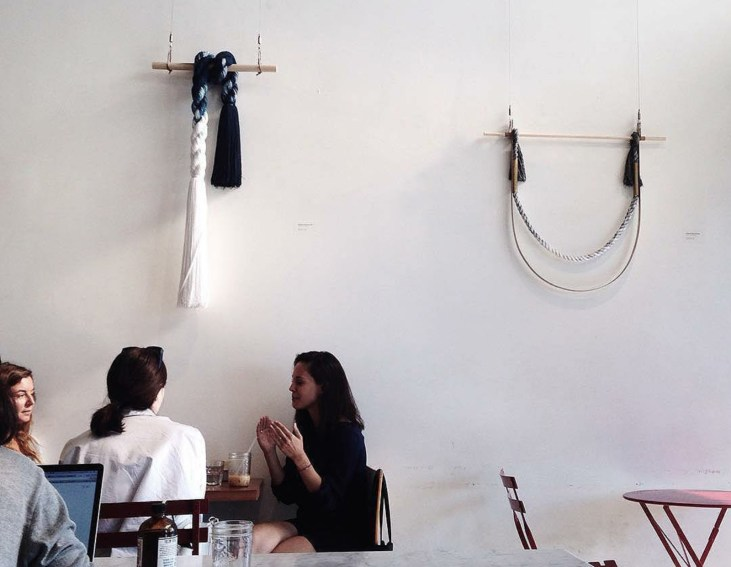 Wall hangings by Cindy Hsu Zell on a restaurant wall