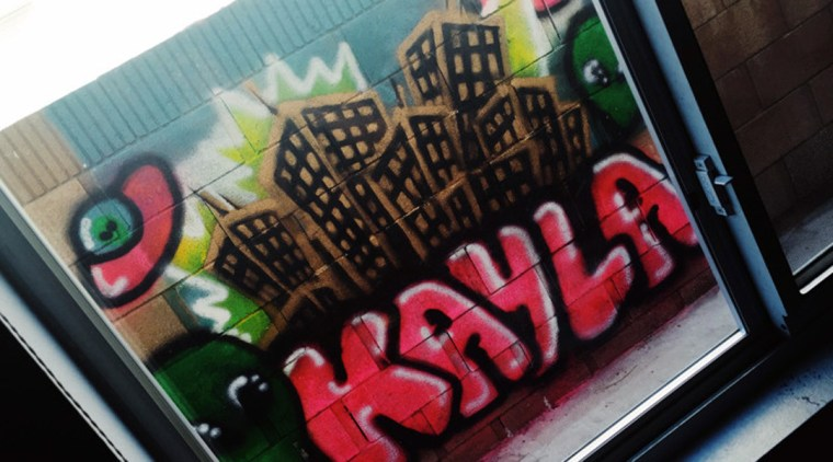 Kayla Sanchez bedroom window showing her graffiti cityscape out the window
