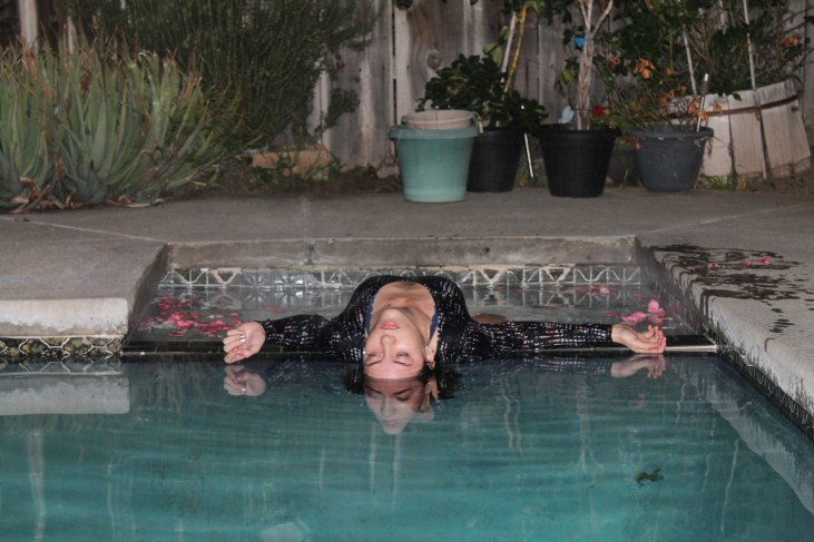 "Megan Stevens floating lifelessly in a pool for the ""Landscapes with a Corpse"" photo activity"