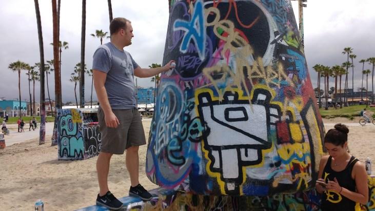 Adam Waldrop & Layla Hadidi painting at the Art Walls at Venice Beach, CA