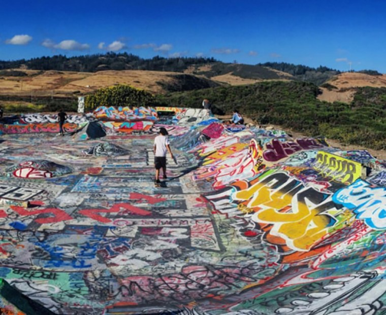 wide shot of a huge basin covered in graffiti writing