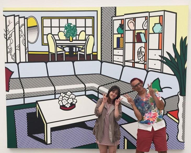 Lisa Bernhauser & Glenn Zucman in front of a large Roy Lichtenstein painting @ The Broad
