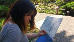 Lisa Bernhauser sketching a landscape at the CSULB Japanese Garden