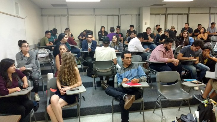 Students in a lecture classroom, FA4-311, in the School of Art at CSULB