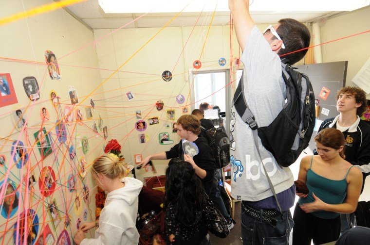 "students ""drawing"" a Fiber Art Social Network on the walls of a faculty office at CSULB"