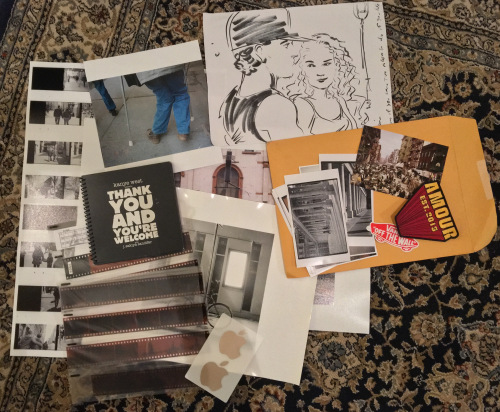 lots of photography ephemera spread out around a large mailing envelope