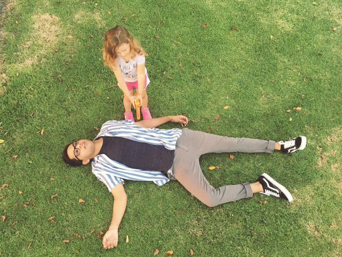 Alex Miramontes' 3-year-old niece pretending to shoot him in the park with a water gun
