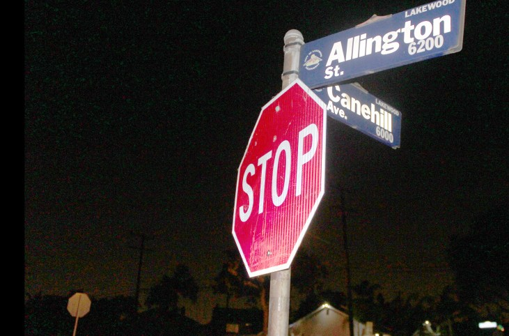 photo of a stop sign at night