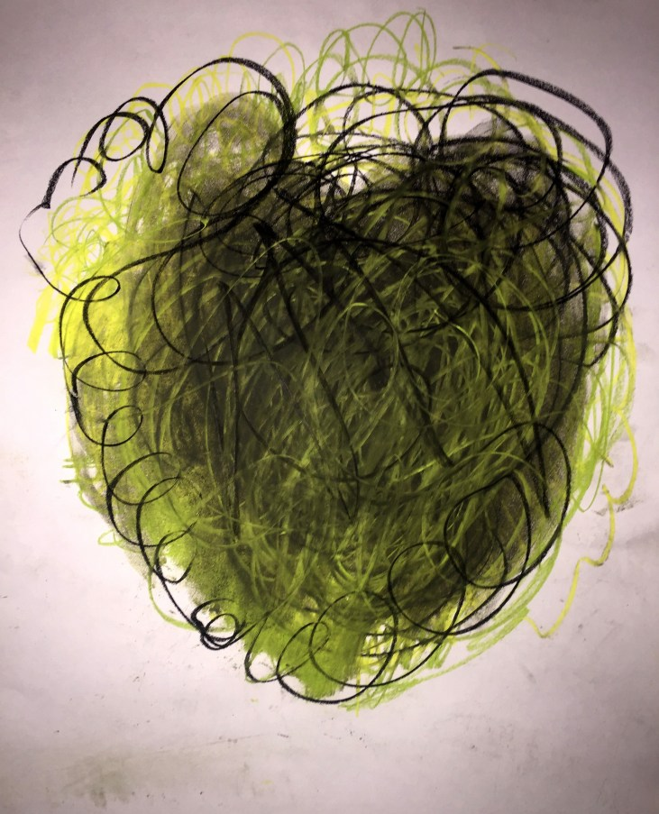 yellow and black pastel markings on paper that make a sort of heart shaped image