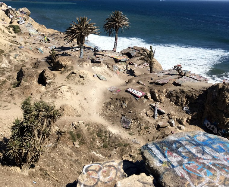wide shot looking down on the rubble and the ocean at Sunken City, San Pedro, CA