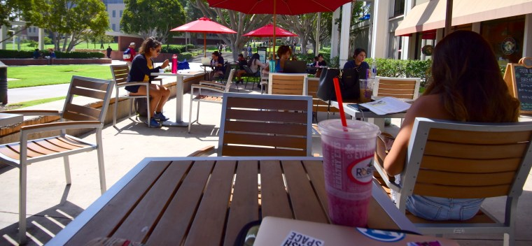 "view of the ""umbrella tables"" outside Robeks / CBTL at the CSULB USU"