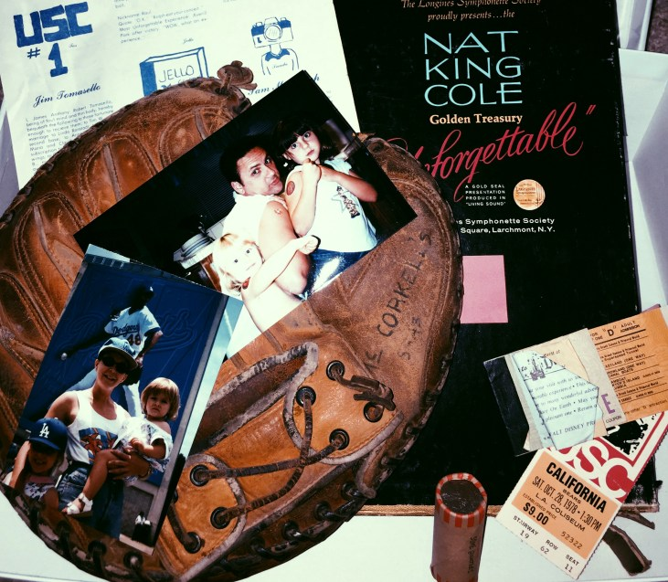 An Art Care Package from Emily Tomasello to her dad, featuring old records, baseball glove, ticket stubs, and other ephemera