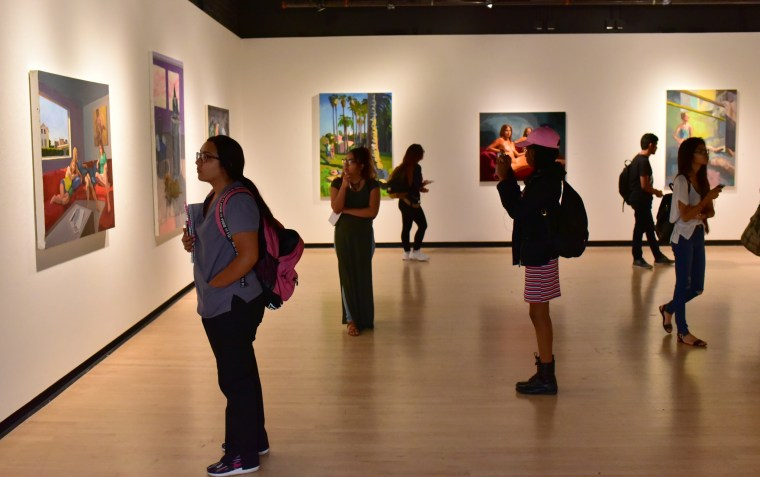 students viewing a painting exhibition at the CSULB SOA Gatov Gallery