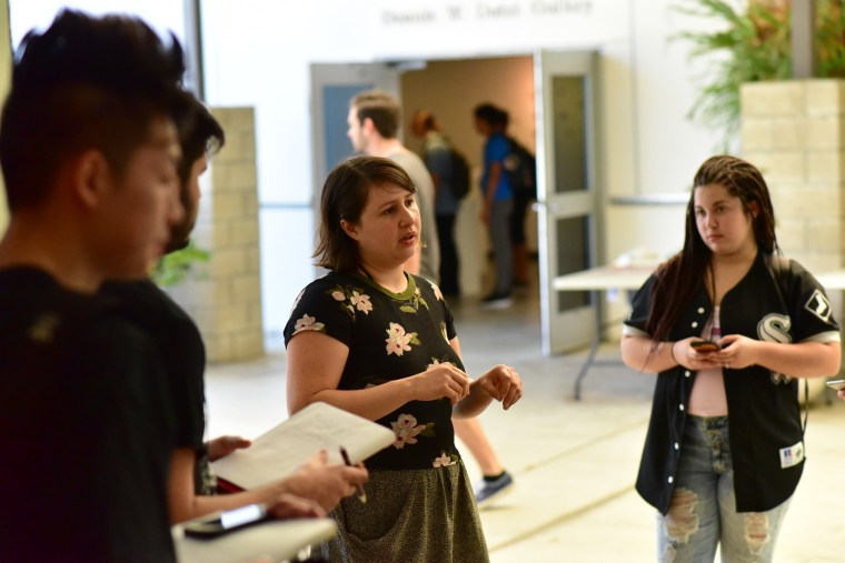 Artist Jane Weibel discussing her work at the CSULB School of Art Galleries