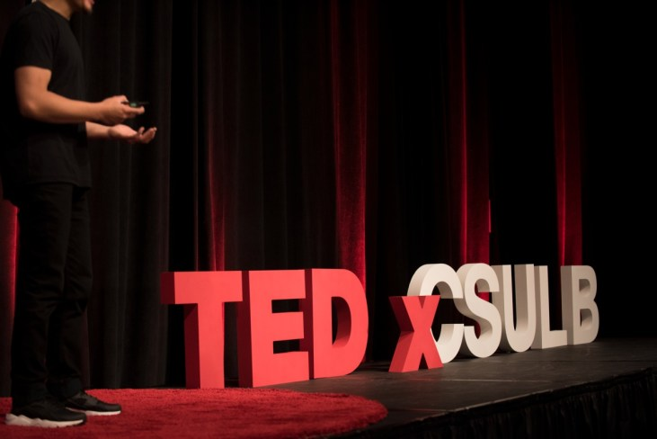 "photo of the TEDxCSULB stage with the name ""TEDxCSULB"" in large, dimensional letters"