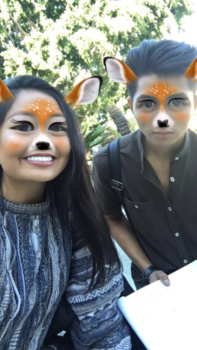 Jillian Ayala & Raul Silva in a Snapchat enhanced selfie where they booth have deer ears, forehead, and noses