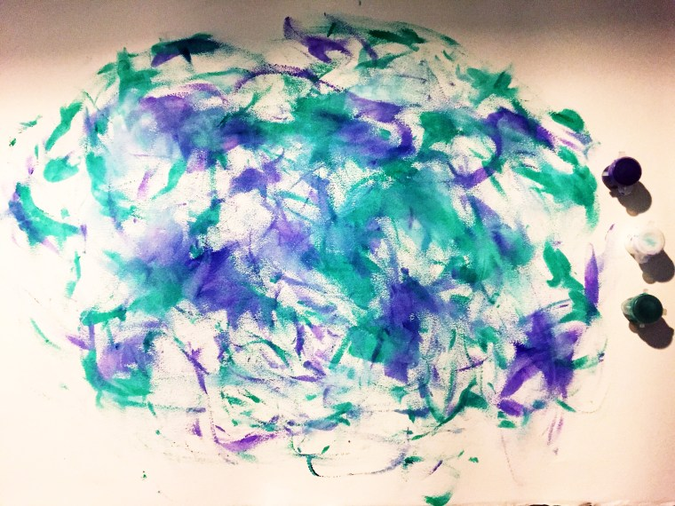 Finger painting by Megan Salinas in staccato, abstract dashes of green and purple