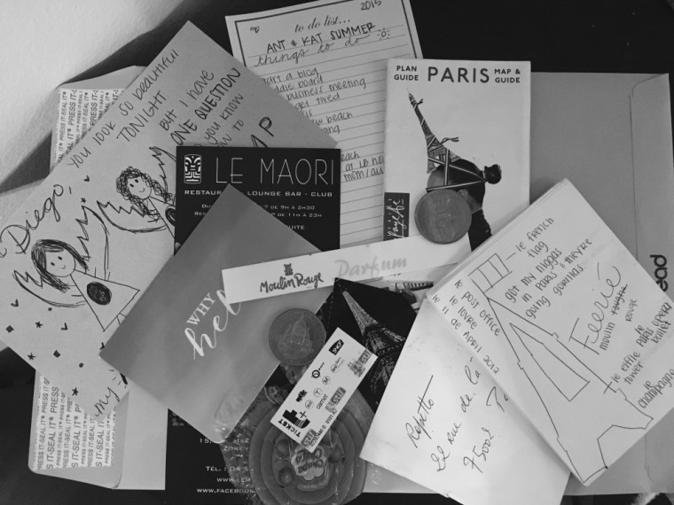 black-and-white photo of various images and bits of ephemera from Antonella to a childhood friend