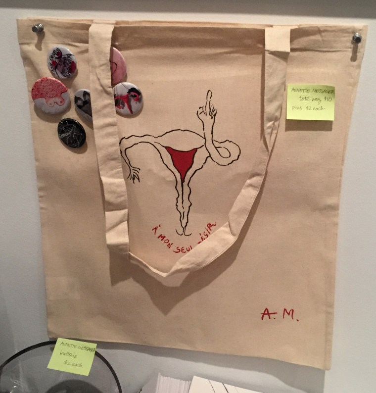 Tote bag by Annette Messager featuring a drawing of fallopian tubes with hands and one is giving a middle finger