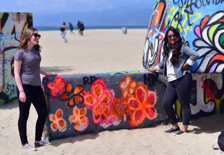 Rachel Palmer & Maria Romo standing at the Art Walls at Venice Beach, CA