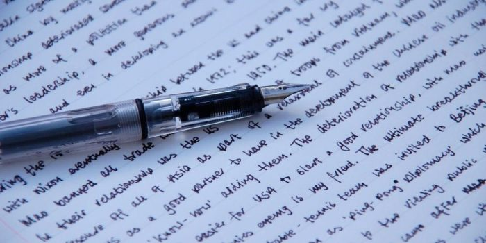 photo of a fountain pen and a page of longhand writing