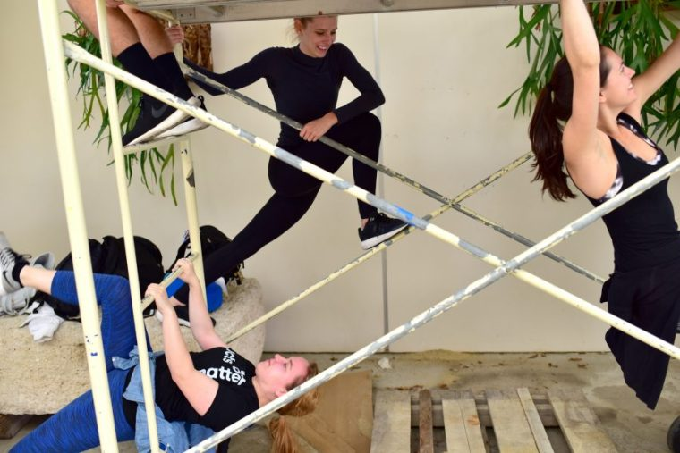 CSULB Dance Majors exploring movement possibilities in the School of Art's Art Gallery Courtyard