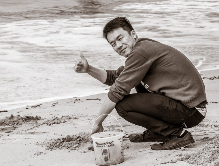 Kewei working in the sand at the Seal Beach Pier