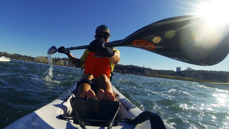 Glenn Zucman paddling a surf ski on the Newport Coast