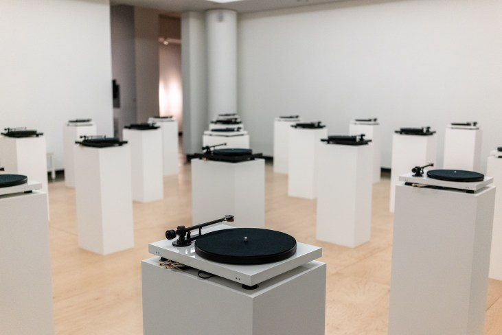 rows of turntables on pedestals in the main gallery of Long Beach State University's University Art Museum