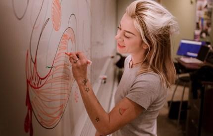 Lizzie Green & Art 110 make a whiteboard mural