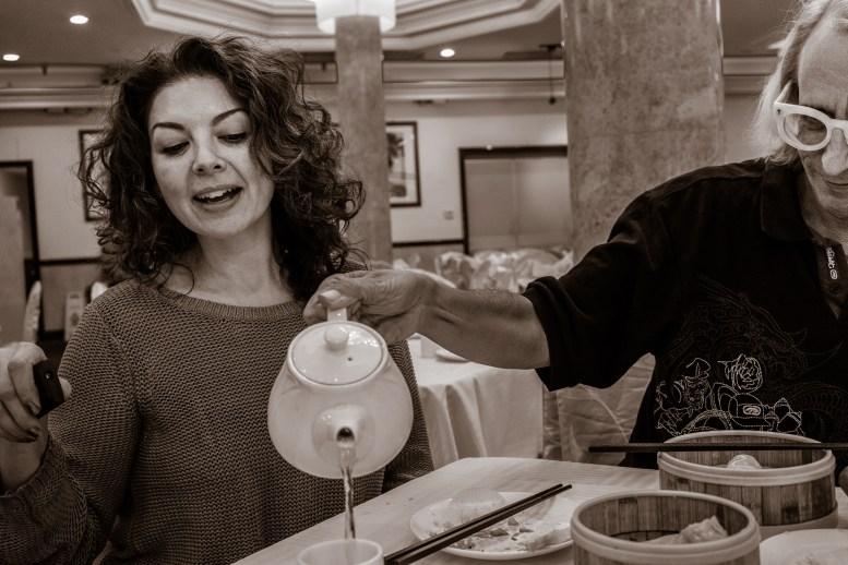 Glenn Zucman pouring tea for Elisa Perez at NBC Seafood in New Taipei, CA