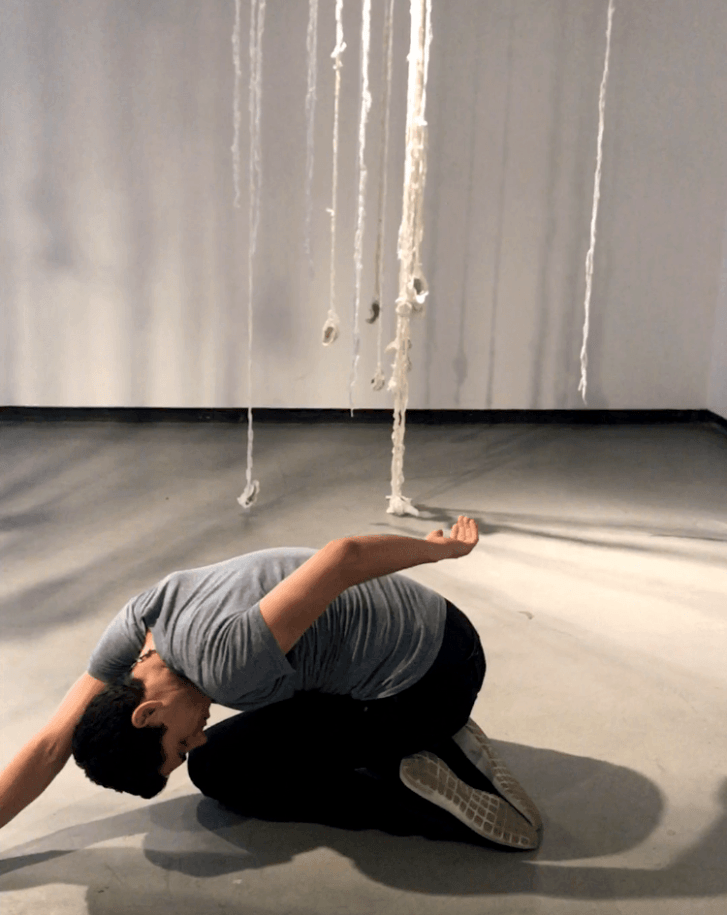 Nathan Moreno performing his own choreography in the CSULB School of Art's Dutzi Gallery in response to Amy Williams' installation _No Redemption Value_