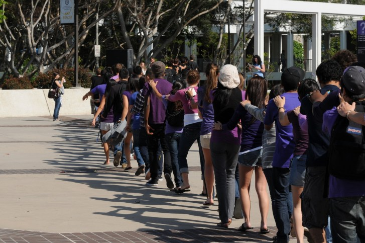 in Heidi Schuster's MP3 Experiment, about 100 CSULB students participate in a large campus performance art work