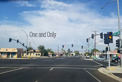 Photo of a stop light in a small town by Rhyane Shanley