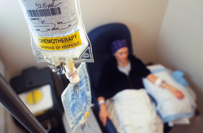 Woman wearing bandana receiving chemotherapy IV