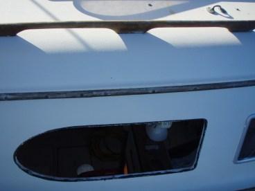 Removed original 1/4″ aluminum-framed Lexan port lights.