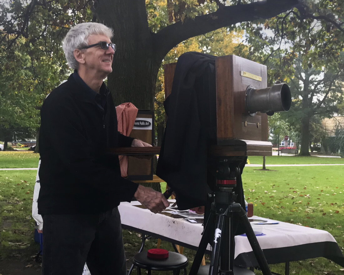 photographer Craig murphy With his reproduction camera and 19th century lens and glens falls art titnype studio in glens falls NY