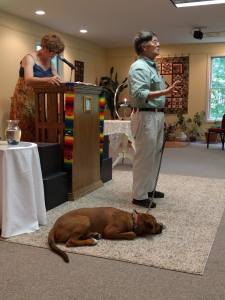 Bob Rockwell and his dog Rocky tell a Story for All Ages at the annual Blessing of the Animals service.