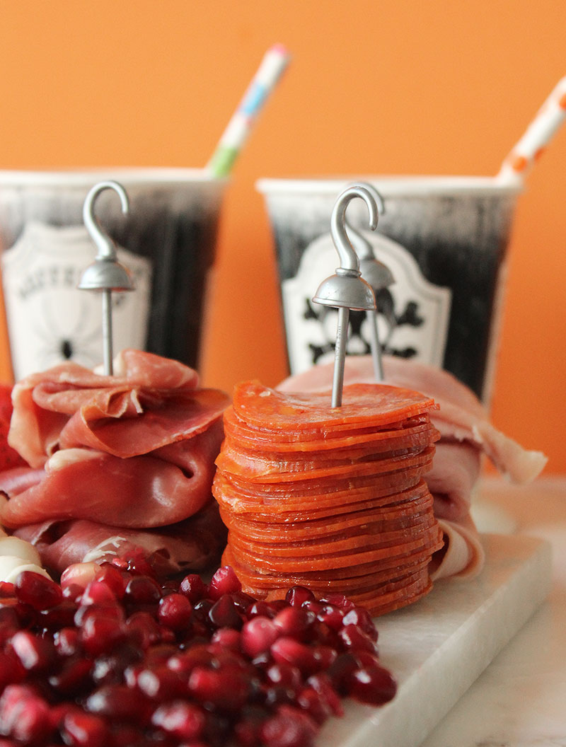 A selection of specialty meat on a Halloween Cheese plate.