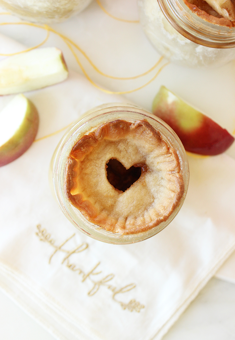 A mini baked apple pie in a jar.