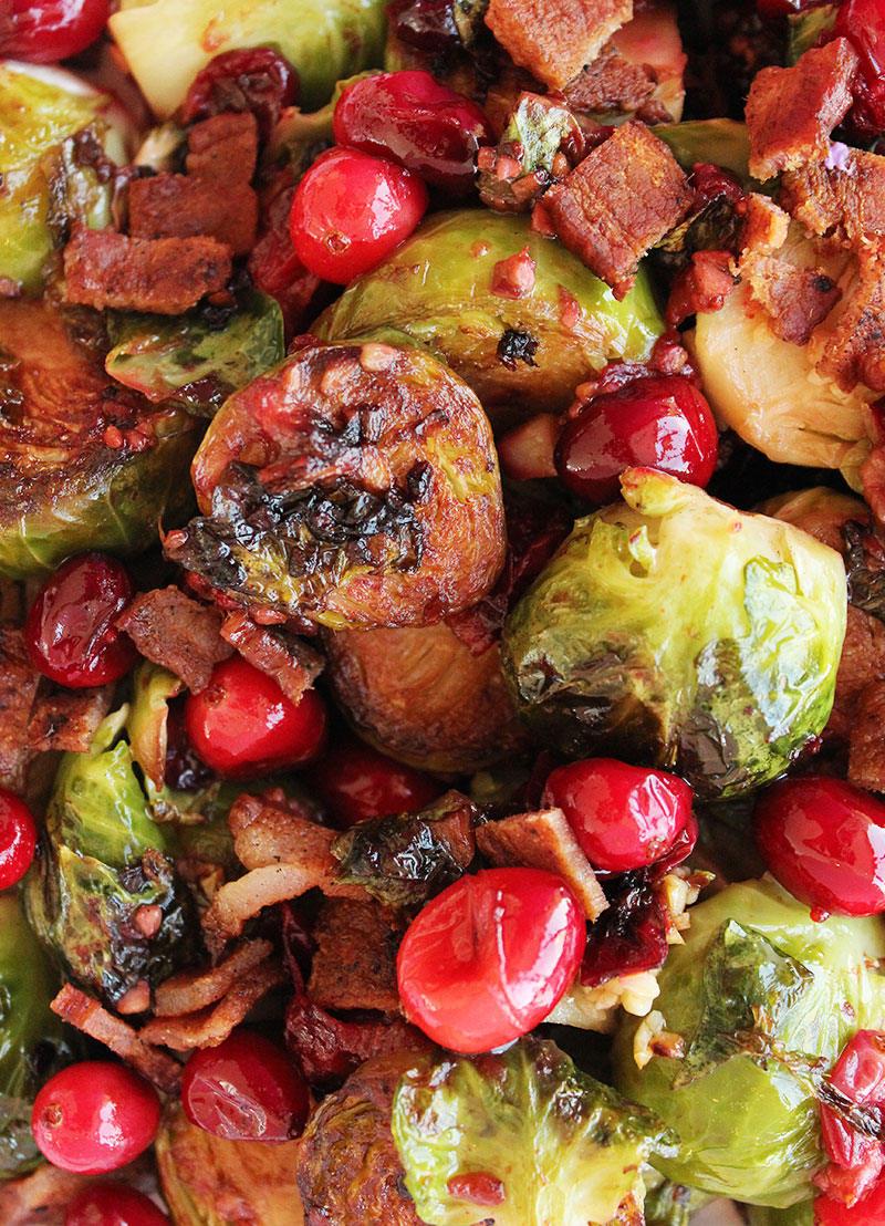 Cooked brussels sprouts with cranberries and bacon.