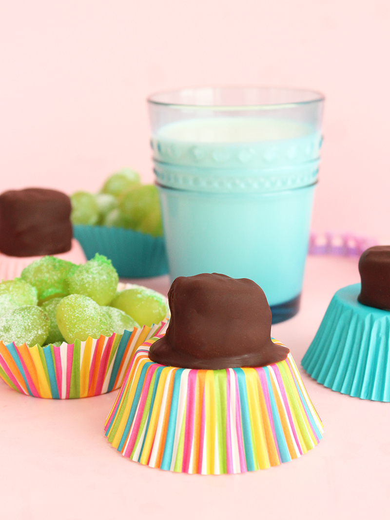 Chocolate banana bites and sour patch kids grapes.