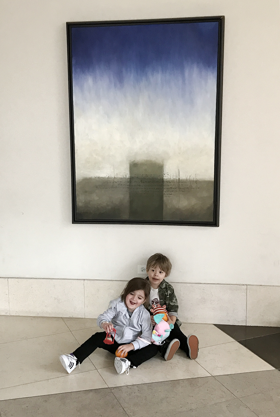Two toddlers hanging out in the lobby at the Swissotel.